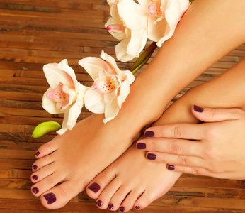 Closeup photo of a female feet at spa salon on pedicure procedure - Soft focus image